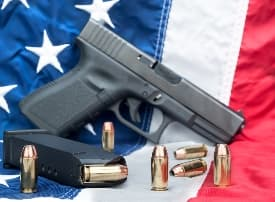 Hand gun, ammo, and American flag