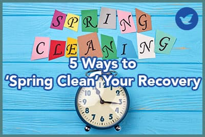 Time for clean up for spring. Blue alarm clock and colorful letters spring cleaning.
