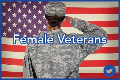 Female Soldier standing in front of and saluting an American flag.