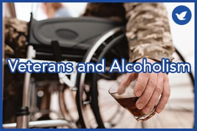The veteran in a wheelchair is depressed. He has problems with alcohol. He holds a glass of whiskey.